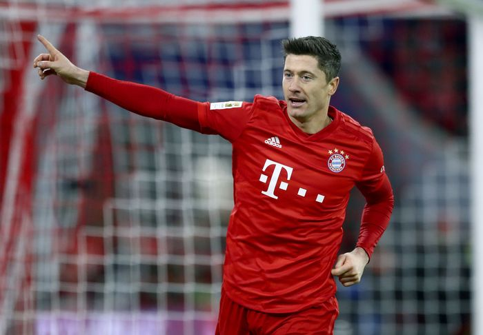 Bayerns Robert Lewandowski celebrates after scoring his sides fourth goal during the German Bundesliga soccer match between FC Bayern Munich and SV Werder Bremen in Munich, Germany, Saturday, Dec. 14, 2019. (AP Photo/Matthias Schrader)
