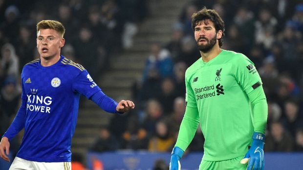 Liverpool's goalkeeper Alisson, right, and Leicester's Harvey Barnes during the English Premier League soccer match between Leicester City and Liverpool at the King Power Stadium in Leicester, England, Thursday, Dec. 26, 2019. (AP Photo/Rui Vieira)