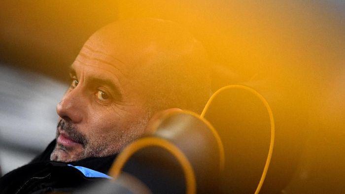 Pep Guardiola tidak akan meninggalkan Manchester City di akhir musim ini. (Foto: Clive Mason / Getty Images)