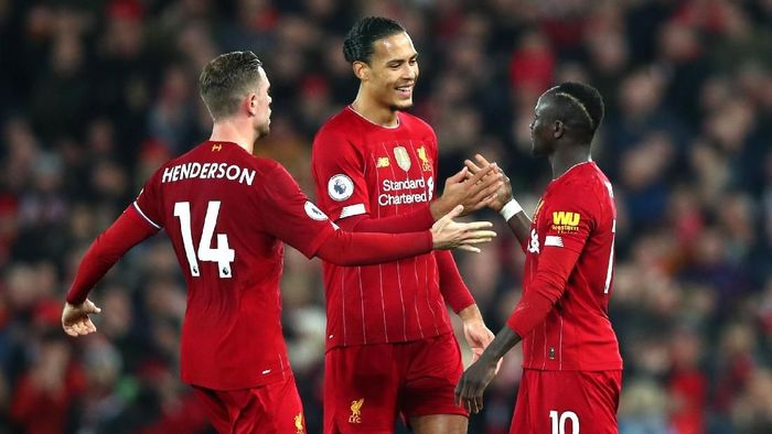 LIVERPOOL, ENGLAND - DECEMBER 29: Sadio Mane of Liverpool celebrates with Virgil van Dijk of Liverpool and Jordan Henderson of Liverpool after scoring his sides first goal during the Premier League match between Liverpool FC and Wolverhampton Wanderers at Anfield on December 29, 2019 in Liverpool, United Kingdom. (Photo by Clive Brunskill/Getty Images)