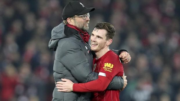 Liverpool's manager Jurgen Klopp embraces Liverpool's Andrew Robertson at the end of the English Premier League soccer match between Liverpool and Wolverhampton Wanderers at Anfield Stadium, Liverpool, England, Sunday Dec. 29, 2019. Liverpool won 1-0. (AP Photo/Jon Super)
