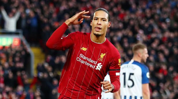 Liverpool FC v Brighton & Hove Albion - Premier LeagueLIVERPOOL, ENGLAND - NOVEMBER 30: Virgil van Dijk of Liverpool celebrates after scoring his teams first goal during the Premier League match between Liverpool FC and Brighton & Hove Albion at Anfield on November 30, 2019 in Liverpool, United Kingdom. (Photo by Clive Brunskill/Getty Images)
