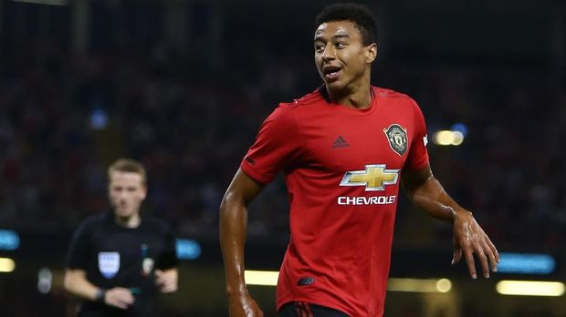 Manchester United's English midfielder Jesse Lingard celebrates after he scores the team's second goal during the 2019 International Champions Cup football match between Manchester United and A C Milan at the Principality Stadium, Cardiff on August 3, 2019. (Photo by GEOFF CADDICK / AFP)