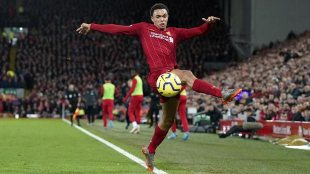 Liverpool's Trent Alexander-Arnold controls the ball during the English Premier League soccer match between Liverpool and Sheffield United at Anfield Stadium, Liverpool, England, Thursday, Jan. 2, 2020. (AP Photo/Jon Super)