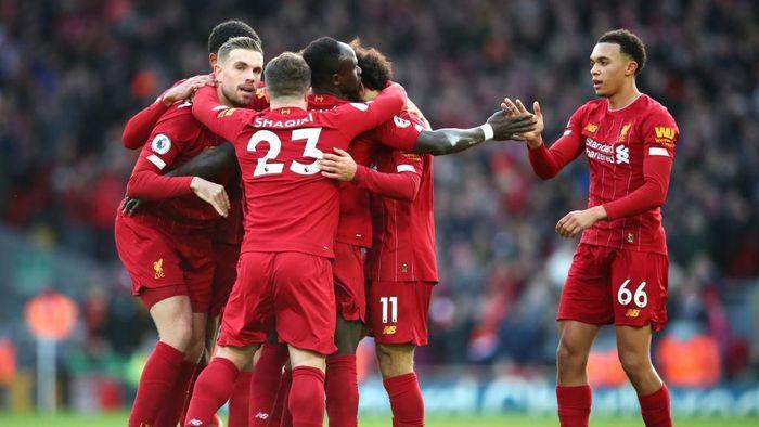 Liverpool punya potensi mematahkan rekor-rekor besar di Liga Inggris pada akhir musim ini (Clive Brunskill/Getty Images)
