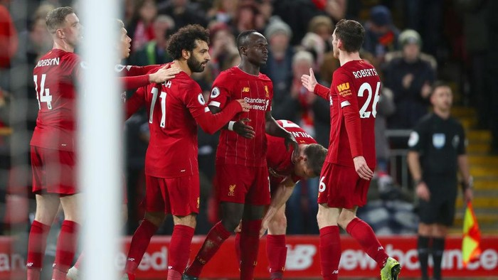 LIVERPOOL, ENGLAND - JANUARY 02: Sadio Mane of Liverpool celebrates with Mohamed Salah and Andy Robertson after scoring his teams second goal during the Premier League match between Liverpool FC and Sheffield United at Anfield on January 02, 2020 in Liverpool, United Kingdom. (Photo by Clive Brunskill/Getty Images)