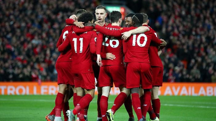 LIVERPOOL, ENGLAND - JANUARY 02: Mohamed Salah of Liverpool celebrates with his team mates after scoring his teams first goal during the Premier League match between Liverpool FC and Sheffield United at Anfield on January 02, 2020 in Liverpool, United Kingdom. (Photo by Clive Brunskill/Getty Images)