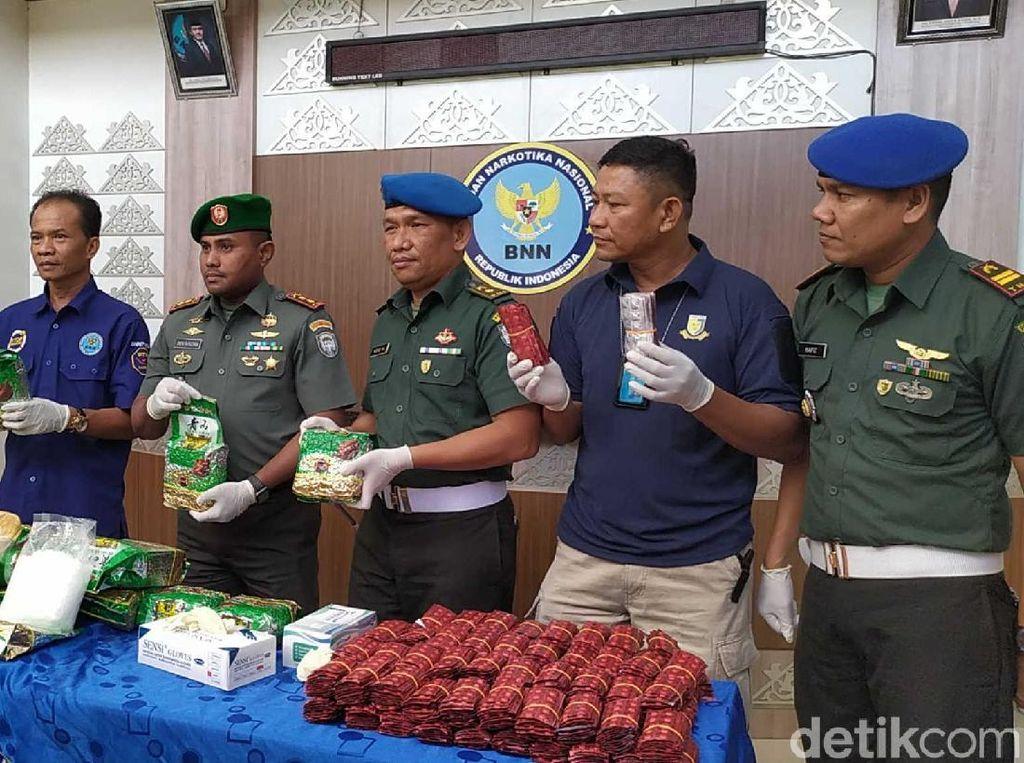 19 Kg Sabu dan 20 Ribu Ekstasi Diamankan TNI di Kebun Sawit, 2 Pria Kabur