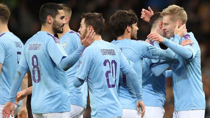 Meski tertinggal jauh dari Liverpool di Liga Inggris, Manchester City masih punya kans juara di tiga kompetisi lain (Foto: Alex Livesey/Getty Images)