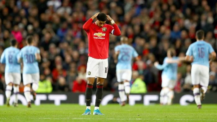 MANCHESTER, ENGLAND - JANUARY 07: Marcus Rashford of Manchester United reacts to Manchester City scoring there third goal during the Carabao Cup Semi Final match between Manchester United and Manchester City at Old Trafford on January 07, 2020 in Manchester, England. (Photo by Michael Steele/Getty Images)