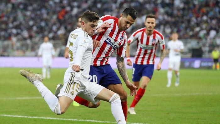 Federico Valverde menentukan kemenangan Real Madrid di Piala Super Spanyol dengan tekelnya. (Foto: Francois Nel/Getty Images)