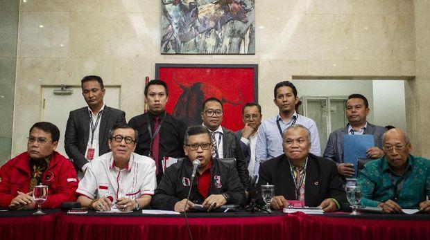 100 Hari Kerja Jokowi dan Gagap KPK Tangani Kasus Harun
