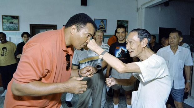 Boxing great Muhammad Ali receives a punch from a 79 old