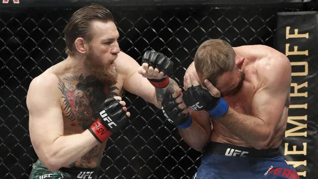 Conor McGregor, left, fights Donald