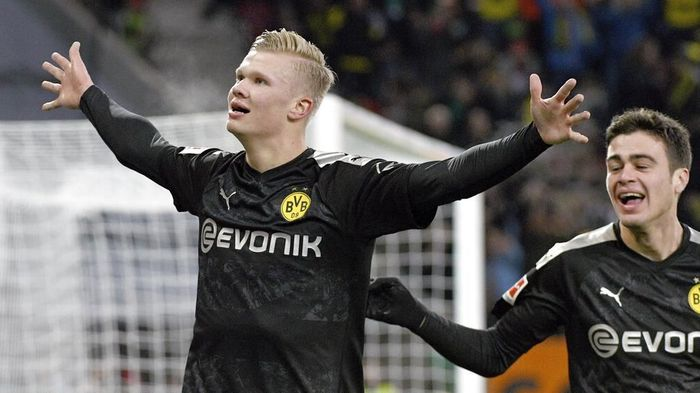 Dortmunds Erling Haaland celebrates after scoring his third goal of the game during the German Bundesliga soccer match between Borussia Dortmund FC Augsburg at the WWK Arena in Augsburg, Germany, Saturday, Jan. 18, 2020. (Tom Weller/dpa via AP)