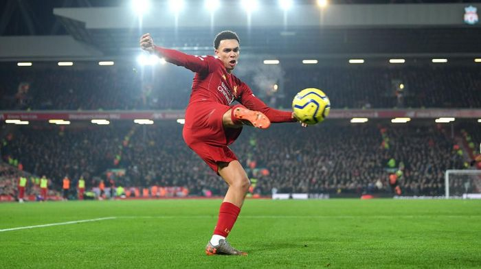 LIVERPOOL, ENGLAND - JANUARY 19: Trent Alexander-Arnold of Liverpool crosses the ball during the Premier League match between Liverpool FC and Manchester United at Anfield on January 19, 2020 in Liverpool, United Kingdom. (Photo by Michael Regan/Getty Images)