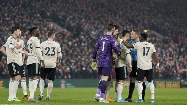 MU kalah 0-2 dari Liverpool.