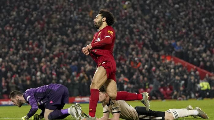 Liverpools Mohamed Salah, centre, celebrates after scoring his sides second goal during the English Premier League soccer match between Liverpool and Manchester United at Anfield Stadium in Liverpool, Sunday, Jan. 19, 2020.(AP Photo/Jon Super)