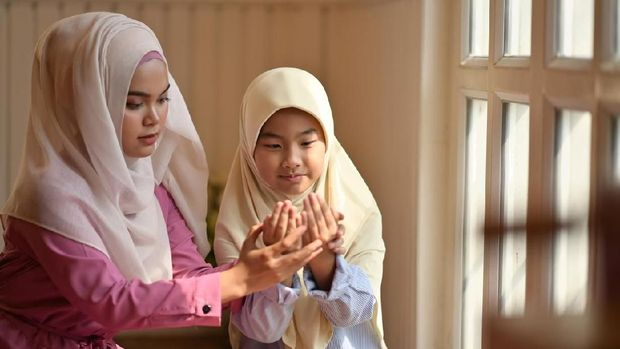 Muslim girl learning how to pray.