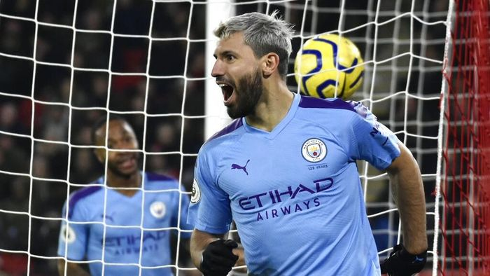 Manchester Citys Sergio Aguero celebrates after scoring his sides opening goal during the English Premier League soccer match between Sheffield United and Manchester City at Bramall Lane in Sheffield, England, Tuesday, Jan. 21, 2020. (AP Photo/Rui Vieira)