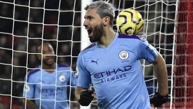 Manchester City's Sergio Aguero celebrates after scoring his side's opening goal during the English Premier League soccer match between Sheffield United and Manchester City at Bramall Lane in Sheffield, England, Tuesday, Jan. 21, 2020. (AP Photo/Rui Vieira)