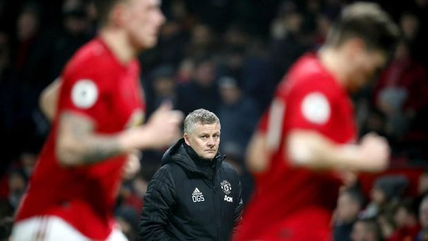 Manchester United manager Ole Gunnar Solskjaer, centre, watches the action from the touchline, during the English Premier League soccer match between Manchester United and Burnley, at Old Trafford, in Manchester, England, Wednesday, Jan. 22, 2020. (Martin Rickett/PA via AP)