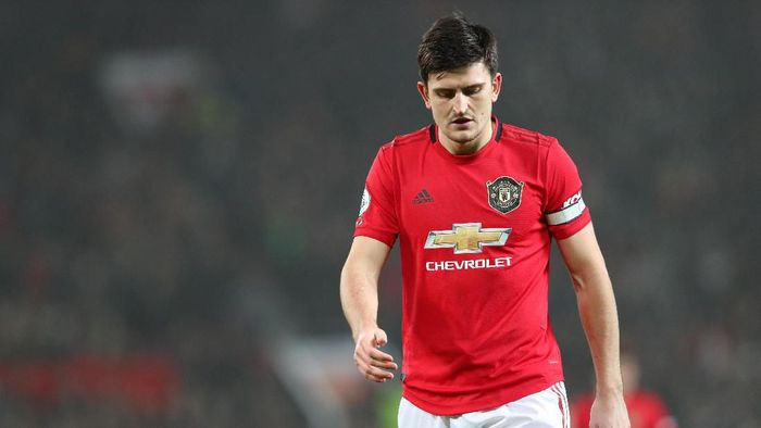 MANCHESTER, ENGLAND - JANUARY 22: Harry Maguire of Manchester United walks off dejected after defeat in the Premier League match between Manchester United and Burnley FC at Old Trafford on January 22, 2020 in Manchester, United Kingdom. (Photo by Alex Livesey/Getty Images)