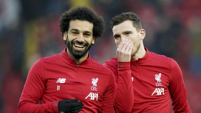 Liverpools Mohamed Salah, left, and Liverpools Andrew Robertson warm up before the English Premier League soccer match between Liverpool and Manchester United at Anfield Stadium in Liverpool, Sunday, Jan. 19, 2020.(AP Photo/Jon Super)
