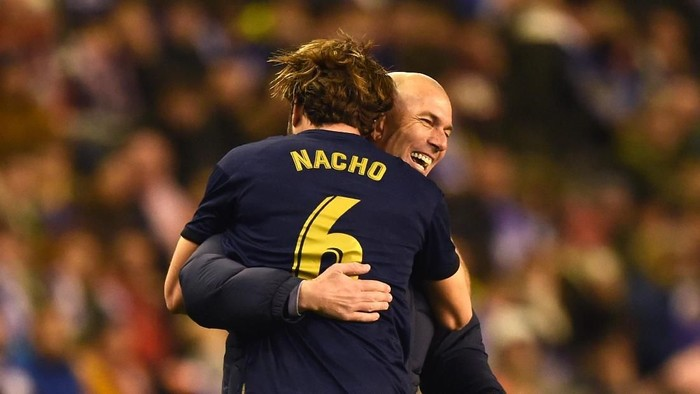 VALLADOLID, SPAIN - JANUARY 26:  Nacho Fernandez of Real Madrid (6) elebrates with Zinedine Zidane, Manager of Real Madrid as scores his teams first goal during the Liga match between Real Valladolid CF and Real Madrid CF at Jose Zorrilla on January 26, 2020 in Valladolid, Spain. (Photo by Denis Doyle/Getty Images)