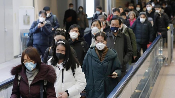 Passengers arriving from the Chinese city of Wuhan arrive at Narita Airport in Chiba, Japan in this photo taken by Kyodo January 23, 2020. Mandatory credit Kyodo/via REUTERS ATTENTION EDITORS - THIS IMAGE WAS PROVIDED BY A THIRD PARTY. MANDATORY CREDIT. JAPAN OUT. NO COMMERCIAL OR EDITORIAL SALES IN JAPAN