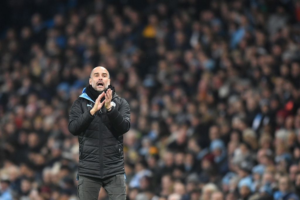 MANCHESTER, ENGLAND - JANUARY 01: Pep Guardiola, Manager of Manchester City gives his team instructions  during the Premier League match between Manchester City and Everton FC at Etihad Stadium on January 01, 2020 in Manchester, United Kingdom. (Photo by Michael Regan/Getty Images)