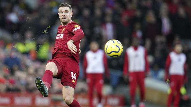 Liverpool's Jordan Henderson passes the ball during the English Premier League soccer match between Liverpool and Southampton at Anfield Stadium, Liverpool, England, Saturday, February 1, 2020. (AP Photo/Jon Super)