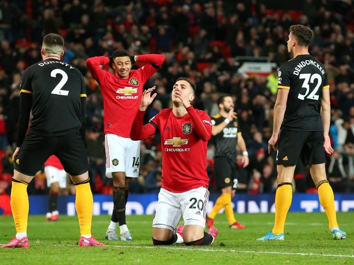 MANCHESTER, ENGLAND - FEBRUARY 01: Diogo Dalot of Manchester United reacts after a missed chance during the Premier League match between Manchester United and Wolverhampton Wanderers at Old Trafford on February 01, 2020 in Manchester, United Kingdom. (Photo by Alex Livesey/Getty Images)