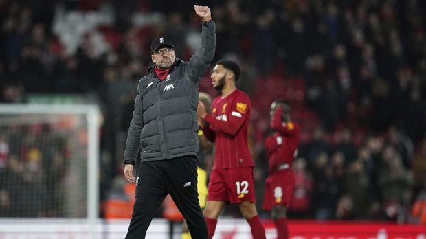 Liverpool's manager Jurgen Klopp greets supporters after the English Premier League soccer match between Liverpool and Southampton at Anfield Stadium, Liverpool, England, Saturday, February 1, 2020. (AP Photo/Jon Super)