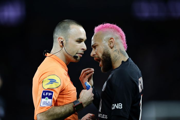 PSGs Neymar talks with French referee Jerome Brisard during the French League One soccer match between Paris-Saint-Germain and Montpellier at the Parc des Princes stadium in Paris, Saturday Feb. 1, 2020. (AP Photo/Christophe Ena)