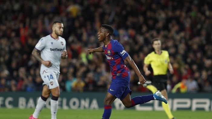 Barcelonas Ansu Fati celebrates after scoring his sides opening goal during a Spanish La Liga soccer match between Barcelona and Levante at the Camp Nou stadium in Barcelona, Spain, Sunday Feb. 2, 2020. (AP Photo/Joan Monfort)