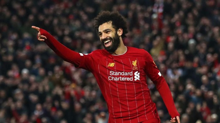 LIVERPOOL, ENGLAND - FEBRUARY 01: Mohamed Salah of Liverpool celebrates after scoring his teams fourth goal during the Premier League match between Liverpool FC and Southampton FC at Anfield on February 01, 2020 in Liverpool, United Kingdom. (Photo by Julian Finney/Getty Images)