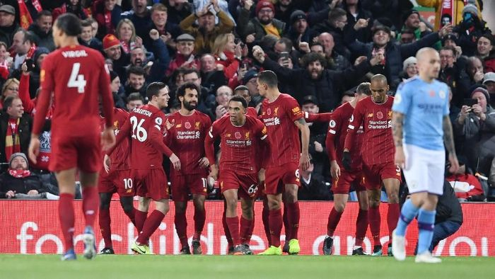 LIVERPOOL, ENGLAND - NOVEMBER 10: Mohamed Salah of Liverpool celebrates with teammates after scoring his teams second goal during the Premier League match between Liverpool FC and Manchester City at Anfield on November 10, 2019 in Liverpool, United Kingdom. (Photo by Laurence Griffiths/Getty Images)
