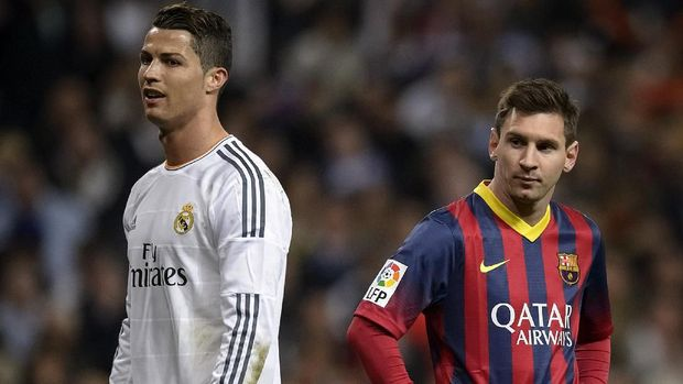Barcelona's Argentinian forward Lionel Messi (R) stands past Real Madrid's Portuguese forward Cristiano Ronaldo during the