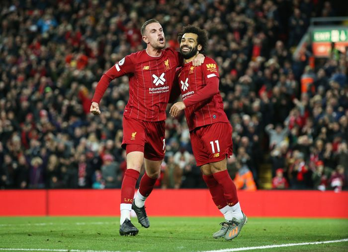 LIVERPOOL, ENGLAND - OCTOBER 27:  Mohamed Salah of Liverpool (11) celebrates as he scores his teams second goal from a penalty with Jordan Henderson during the Premier League match between Liverpool FC and Tottenham Hotspur at Anfield on October 27, 2019 in Liverpool, United Kingdom. (Photo by Jan Kruger/Getty Images)