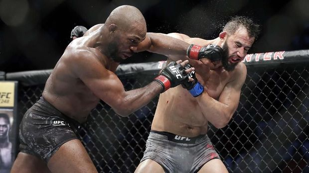 Jon Jones, left, connects with a punch to the face of Dominick Reyes, right, during a light heavyweight mixed martial arts bout at UFC 247 Sunday, Feb. 9, 2020, in Houston. (AP Photo/Michael Wyke)