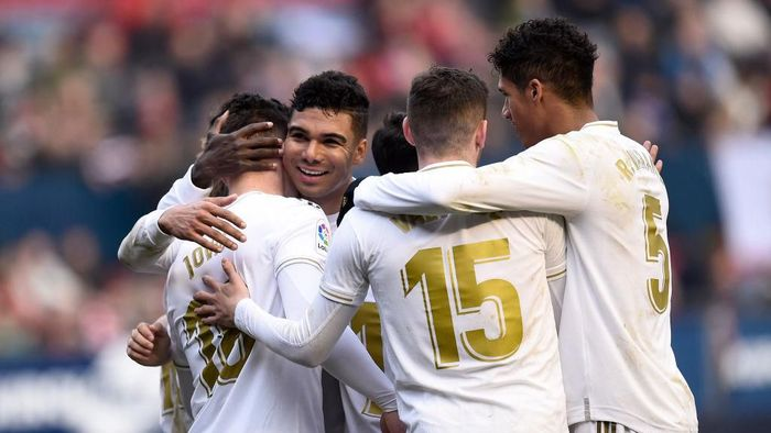 PAMPLONA, SPAIN - FEBRUARY 09: Luka Jovic of Real Madrid celebrates with his team mates after scoring his teams fourth goal during the La Liga match between CA Osasuna and Real Madrid CF at El Sadar Stadium on February 09, 2020 in Pamplona, Spain. (Photo by Juan Manuel Serrano Arce/Getty Images)