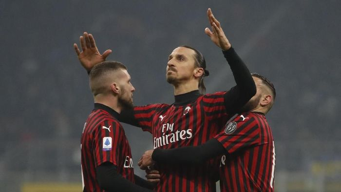 AC Milans Zlatan Ibrahimovic, centre, celebrates with his teammates after he scored his sides second goal during the Serie A soccer match between Inter Milan and AC Milan at the San Siro Stadium, in Milan, Italy, Sunday, Feb. 9, 2020. (AP Photo/Antonio Calanni)
