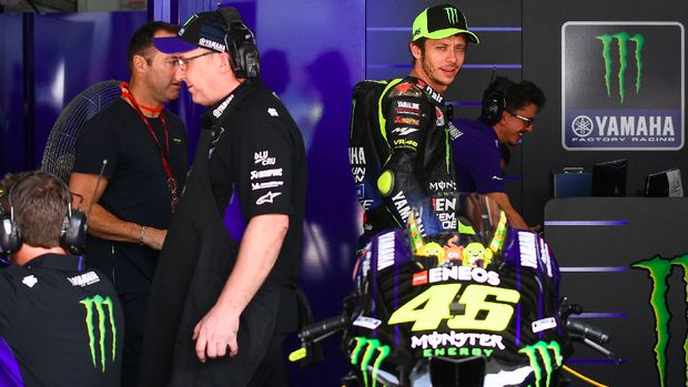 Monster Energy Yamaha's Italian rider Valentino Rossi (2nd R) walks inside his team garage during the first day of the pre-season MotoGP winter test at the Sepang International Circuit in Sepang on February 7, 2020.Mohd RASFAN / AFP