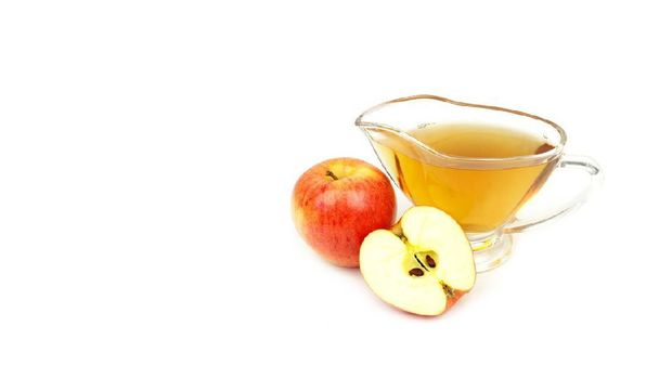 Apple cider vinegar isolated on white background