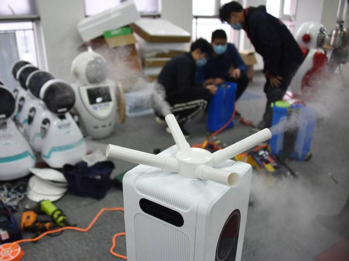 Medical workers checking on the robots that will be put on to the streets in China in the fight against the COVID-19 (coronavirus) outbreak in the country. A disinfection robot has been developed by scientists in Soochow University at Qingdao, East Chinas Shandong province, on Wednesday (Feb 12). - Xinhua/ANN
