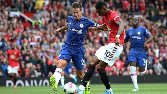 MANCHESTER, ENGLAND - AUGUST 11:  Marcus Rashford of Manchester United scores the third goal during the Premier League match between Manchester United and Chelsea FC at Old Trafford on August 11, 2019 in Manchester, United Kingdom. (Photo by Julian Finney/Getty Images)