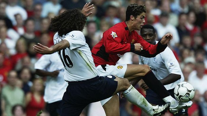 MANCHESTER - AUGUST 16:  Cristiano Ronaldo of Manchester United is challenged by Ivan Campo of Bolton Wanderers during the FA Barclaycard Premiership match held on August 16, 2003 at Old Trafford, in Manchester, England. Manchester United won the match 4-0. (Photo by Alex Livesey/Getty Images)