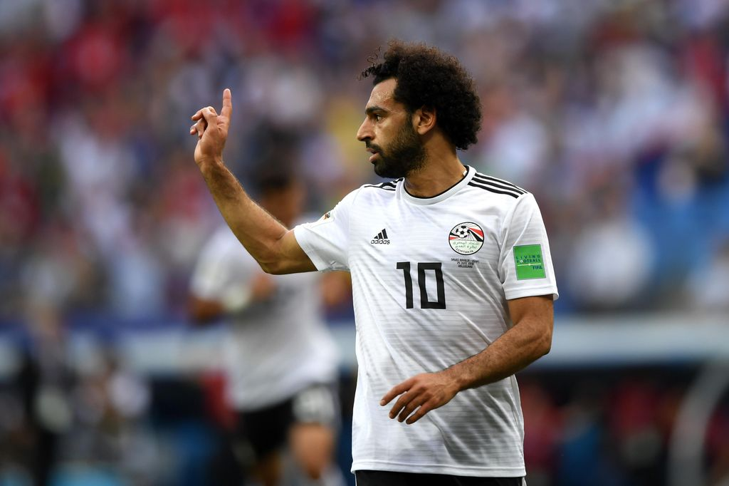 VOLGOGRAD, RUSSIA - JUNE 25:  Mohamed Salah of Egypt celebrates after scoring his sides opening goal during the 2018 FIFA World Cup Russia group A match between Saudia Arabia and Egypt at Volgograd Arena on June 25, 2018 in Volgograd, Russia.  (Photo by Shaun Botterill/Getty Images)