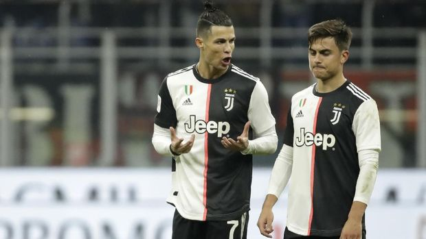 Juventus' Cristiano Ronaldo, left, speaks with Juventus' Paulo Dybala at the end of the Italian Cup soccer match between AC Milan and Juventus at the San Siro stadium, in Milan, Italy, Thursday, Feb. 13, 2020. (AP Photo/Luca Bruno)